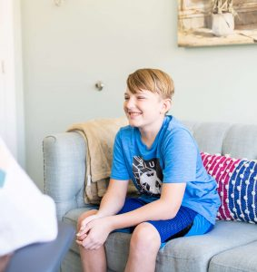A young boy interacting with a therapist in an office